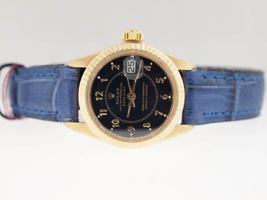 10: Rolex Ladies 18k Gold Datejust. Blue Strap.