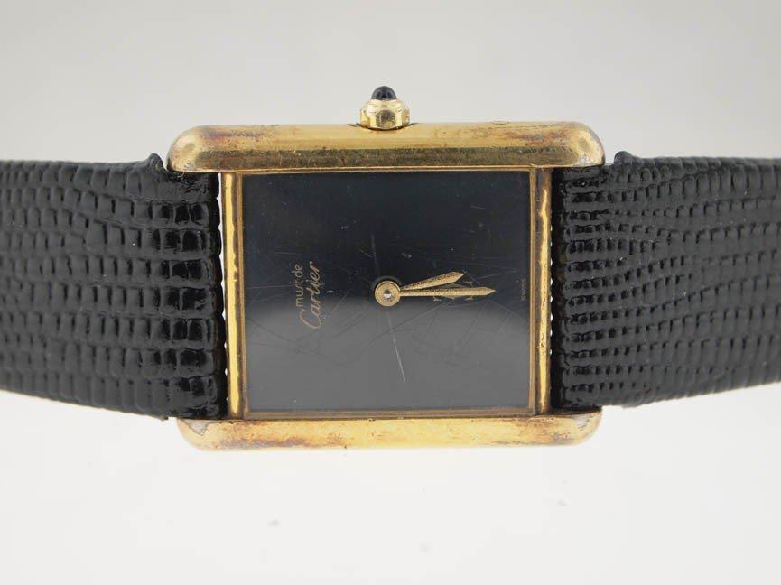21: Cartier Ladies Gold Vermeil Tank. Leather Strap.