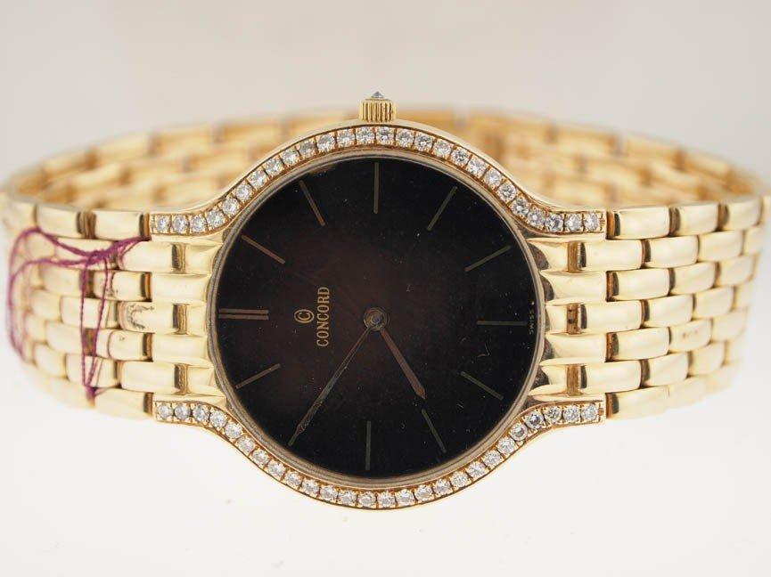 26: Concord 14k Gold Diamond Watch.