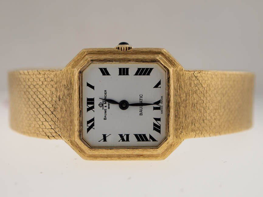 2: Baum & Mercier Ladies 18k Gold Octagon.