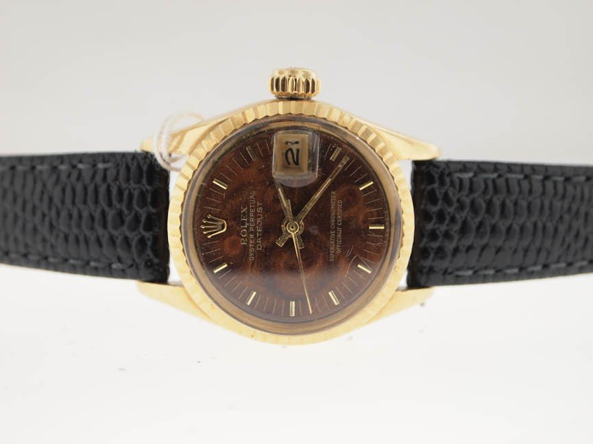 4: Rolex Ladies 18k Datejust. Leather Strap.