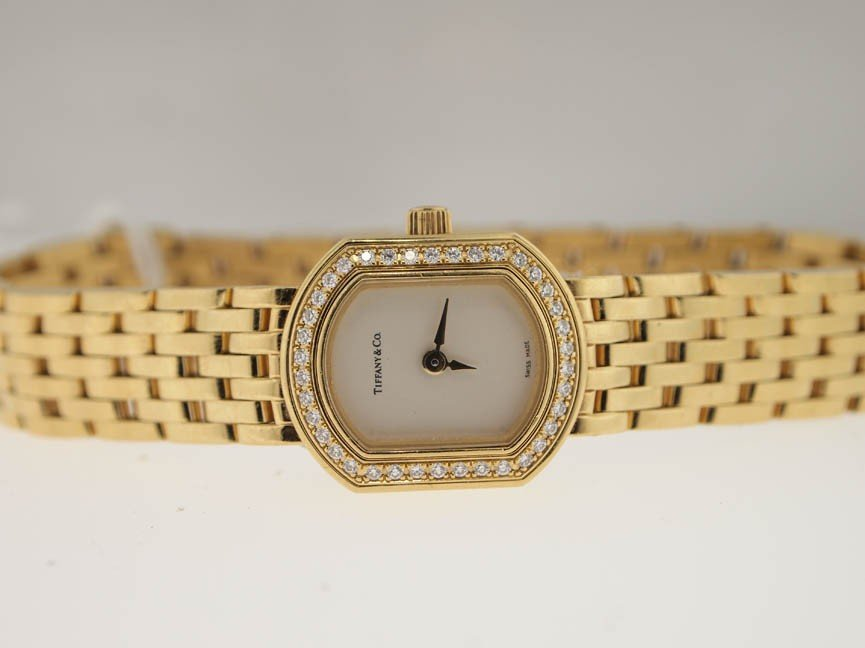 7: Tiffany & Co Ladies 18k Gold Diamond Watch. PAPERS.