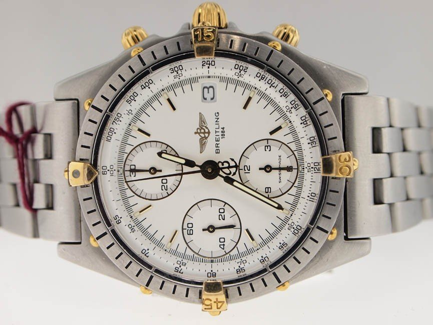 19: Breitling Mens 18k Gold and SS Chronograph.