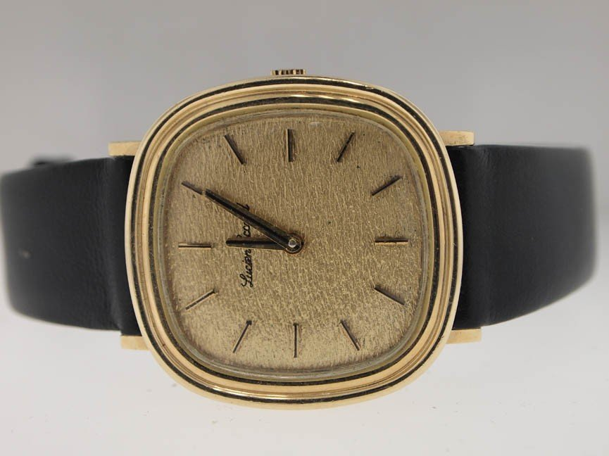 26: Lucien Piccard Mens 14k Gold Dress Watch.