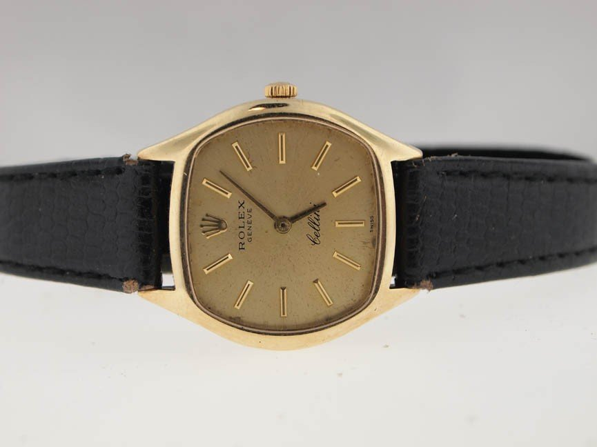 22: Rolex Ladies 18k Gold Cellini Dress Watch.