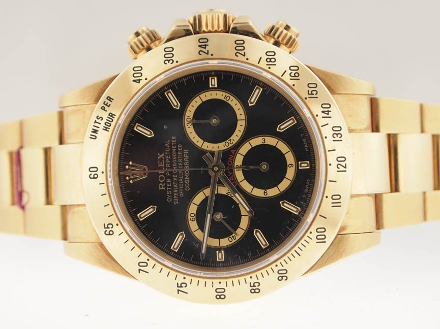 122: Rolex Mens 18k Gold Daytona. 1993. Like New.