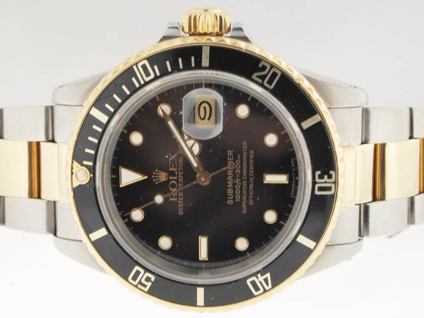 11: Rolex Mens 18k and SS Submariner.