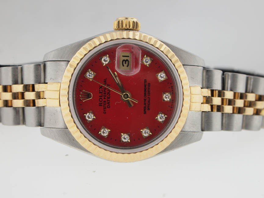 20: Rolex Ladies 18k and SS Datejust. Red Diamond Dial.