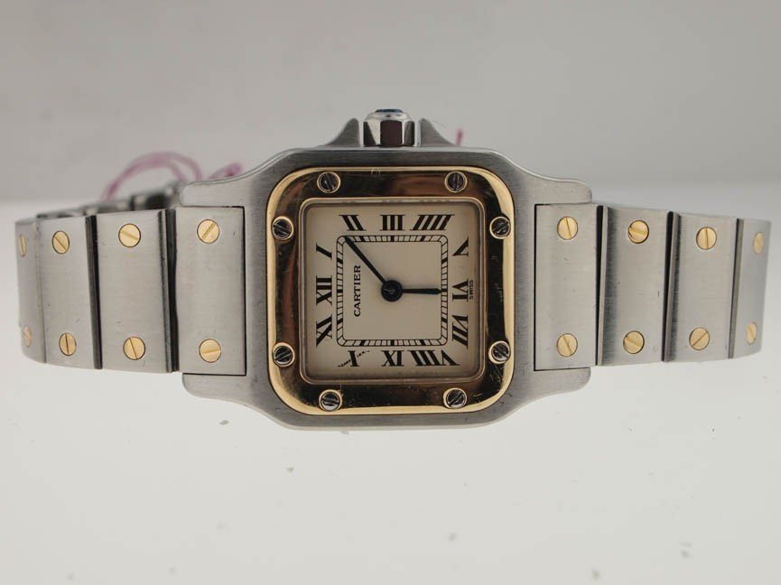 22: Cartier Ladies 18k and SS Santos.