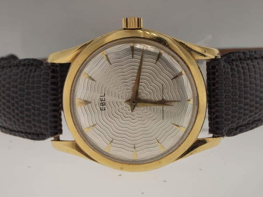 62: Ebel Mens 14k Gold Vintage Watch. Leather Strap.