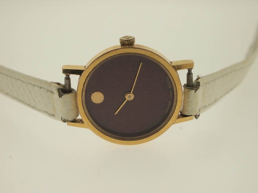 3: Movado Ladies Gold Vermeil Watch.