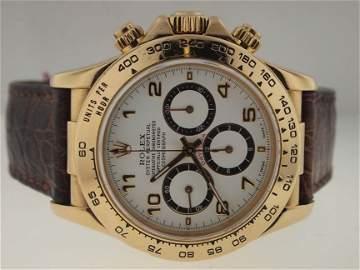 64: Rolex Mens 18k Gold Daytona. PAPERS.