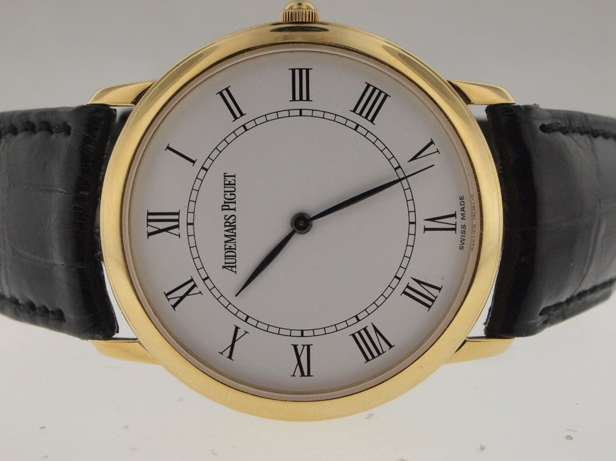 7: Audemars Piguet 18k Manual Wind Dress Watch.