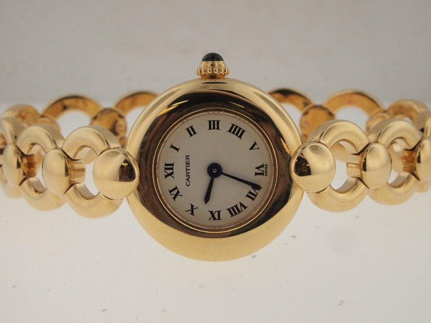 52: Cartier Ladies 18k Gold Boutique Watch.