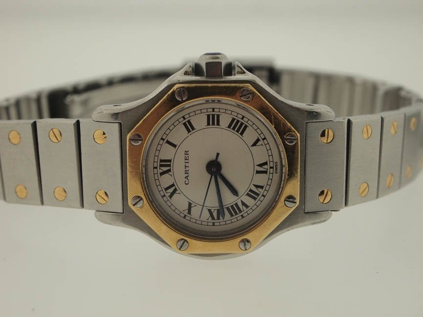 69: Cartier Ladies 18k and SS Octagon Santos Auto.