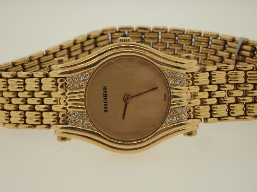 15: Bucherer Ladies 18k Gold Diamond Watch. 37.3 DWT.