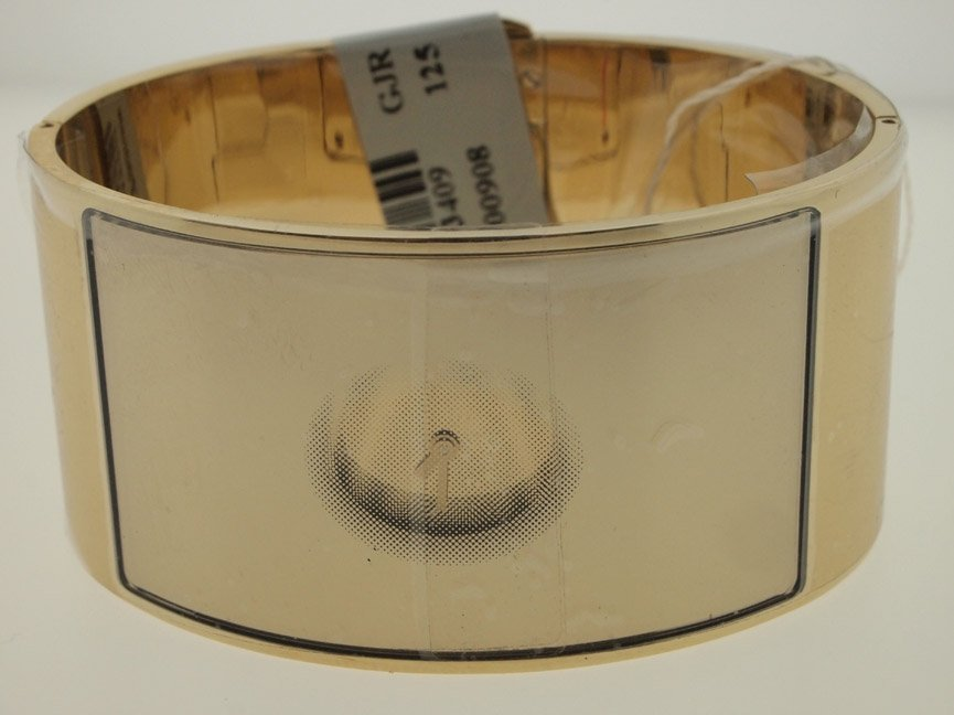 20: Calvin Klein Ladies Gold Tone Bangle Watch.