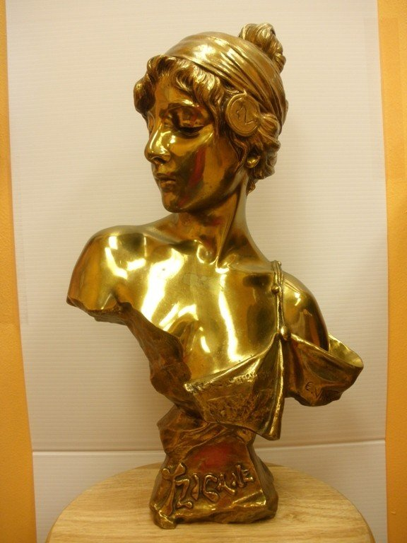 12: A FRENCH ART NOUVEAU BRONZE BUST  CAST FROM A MODEL