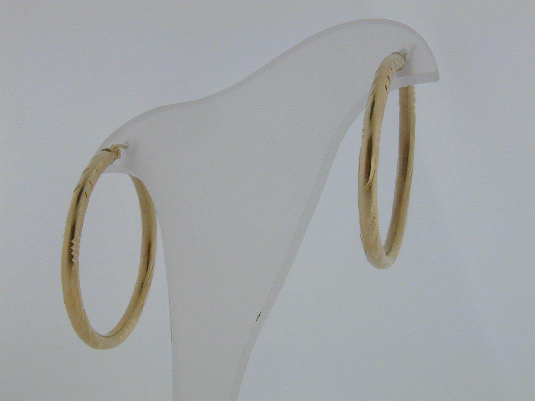 "123: Gold Diamond cut 1.5"" hoops"