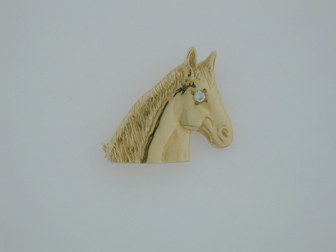 141: Gold and diamond Horse head brooch