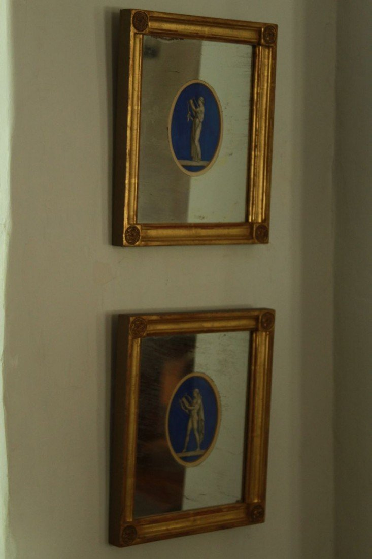 68: Pair of painted French mirrors with a roman theme