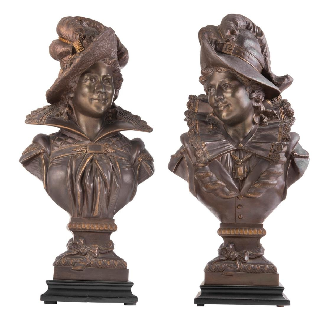 A PAIR OF BUSTS OF LADIES WEARING HATS. CA. 1900.