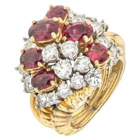 An 18K yellow and white gold ring with 6 rubies 2.70