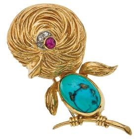 An 18K yellow gold brooch with 1 turquoise cabochon, 1