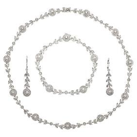 A 14K white gold set of necklace, bracelet and pair of