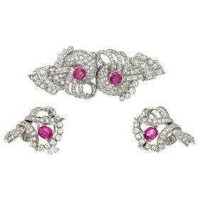 A 14K white gold set of double clip brooch and pair of