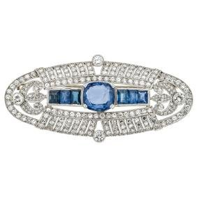 A platinum and 14K white gold brooch with 7 oval and