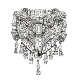 A platinum brooch with 263 marquise, baguette,