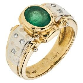 An 18K yellow gold ring with 1 emerald 1.20 carats and