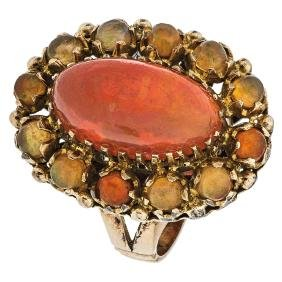 A 10K yellow gold ring with 1 opal cabochon 3.50 carats
