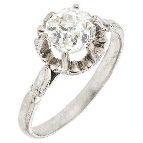A silver palladium solitaire ring with 1 old cut