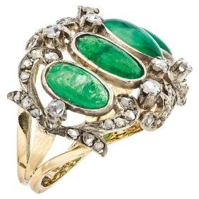 An 18K yellow gold and silver ring with 4 emerald