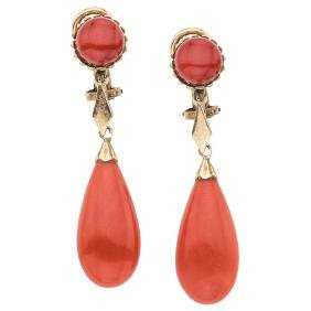 A 10K yellow gold pair of earrings with 4 corals.