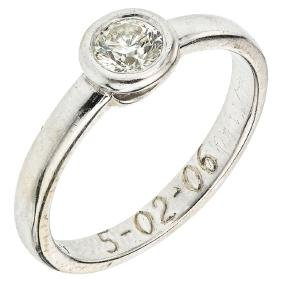A BIZARRO 14K white gold solitaire ring with 1