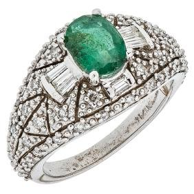 A 14K white gold ring with 1 oval cut emerald 0.65