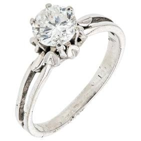 An 18K white gold solitaire ring with 1 brilliant cut