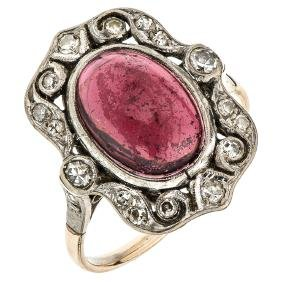 An 8K yellow gold ring with 1 ruby cabochon 3.35 carats