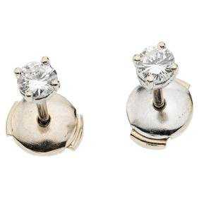 A 14K white gold pair of stud earrings with 2 brilliant