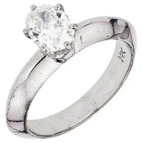 A silver palladium solitaire ring with 1 oval cut