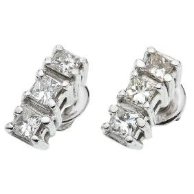 A 14K white gold pair of stud earrings with 6 princess