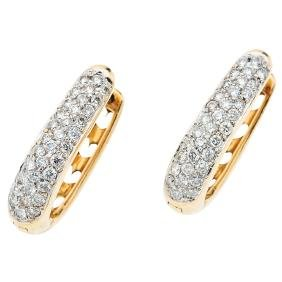 A 14K yellow gold pair of hoop earrings with 68