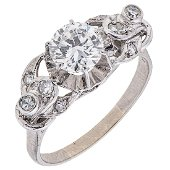 An 18K white gold ring with 1 brilliant cut diamond