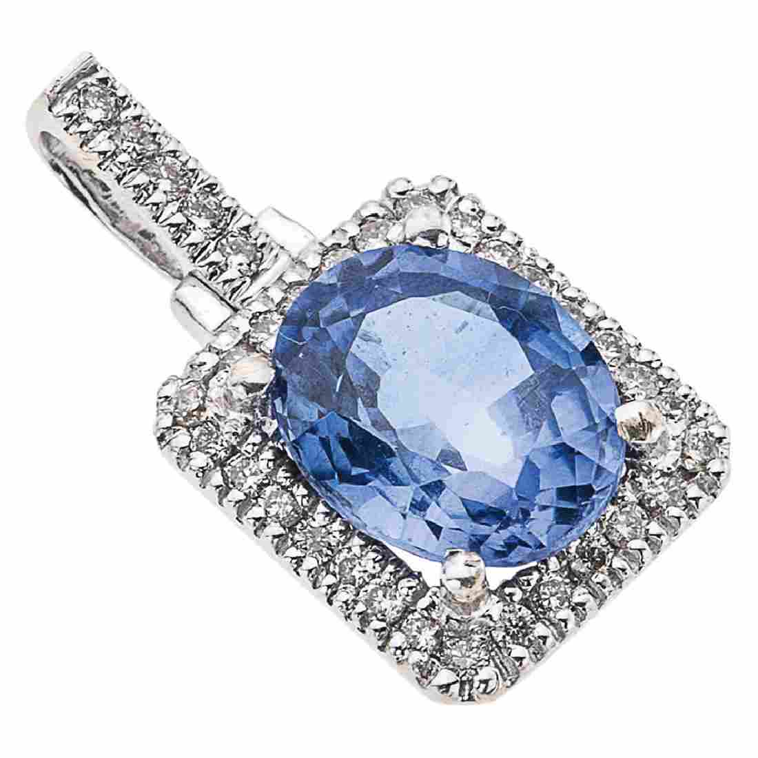 A 14K white gold pendant with 1 oval cut sapphire ~4.20