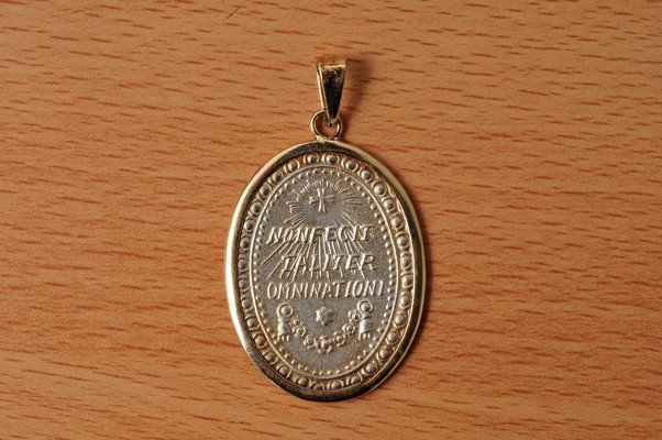 16: Religious stamped medal