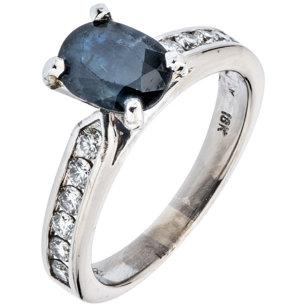 A 18K  WHITE GOLD RING WITH 1 SAPPHIRE ~1.60 quilates
