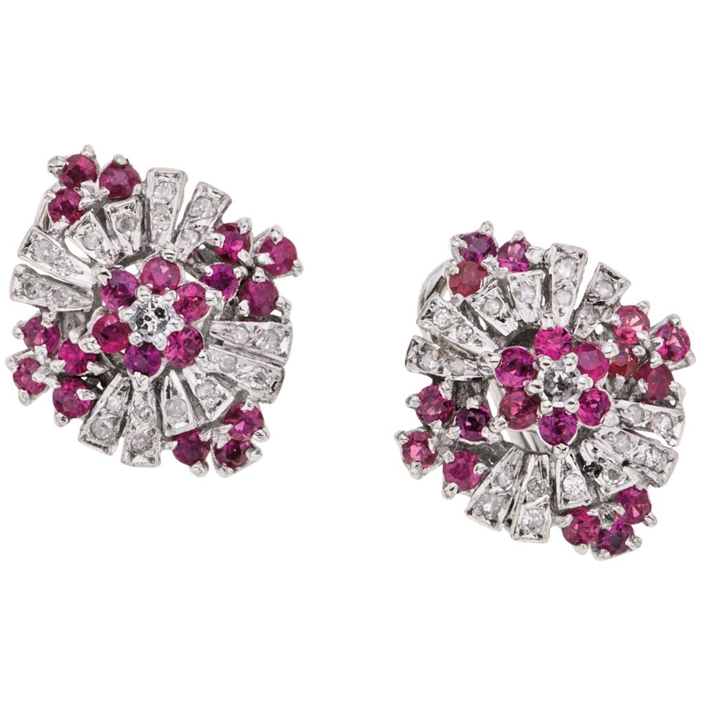 A 14K white gold pair of earrings with 40 rubies ~0.50